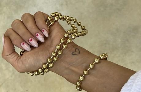 סט שרשרת וצמיד כדורים בגוון זהב בהיר